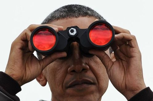 US President Barack Obama looks through binoculars towards North Korea from Observation Post Ouellette in South Korea-772222